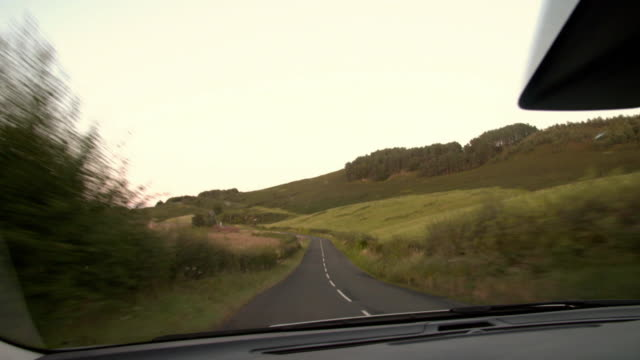pov sequence showing country fields from a car fkah380j aeyz199p - rural scene stock videos & royalty-free footage