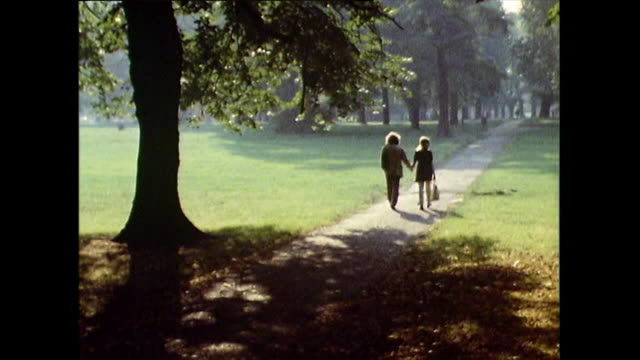 sequence showing couples relaxing in hyde park; 1971 - letterbox stock videos & royalty-free footage