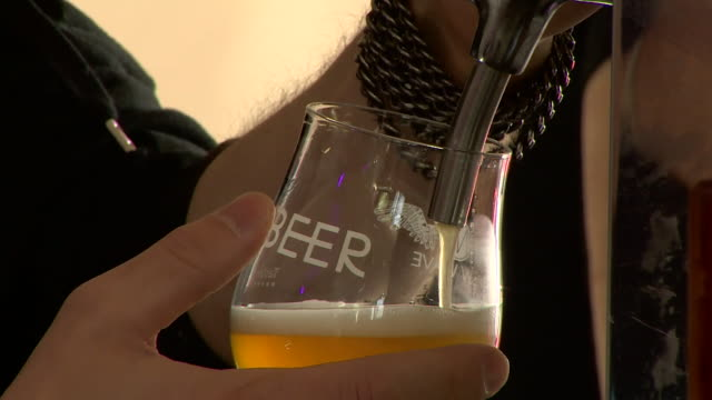 sequence showing craft beer being pulled in a bar in edinburgh, scotland - alcohol drink stock videos & royalty-free footage