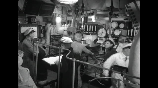 vídeos y material grabado en eventos de stock de sequence showing crew members working in the engine room of a uk aircraft carrier - panel de control