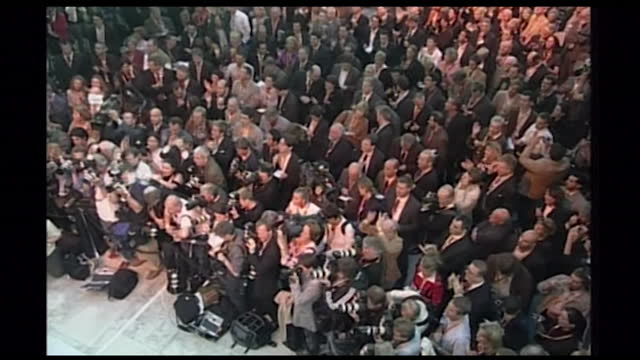 sequence showing crowds of people applauding angela merkel at an election rally in germany; 2005. has crowds of people clapping. has angela merkel on... - 2005 stock-videos und b-roll-filmmaterial