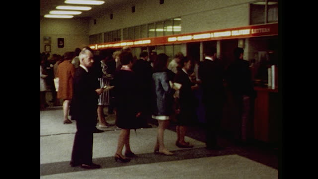 sequence showing customers inside a post office on london's great portland street. - postage stamp stock videos & royalty-free footage