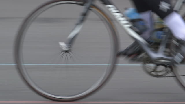 sequence showing cyclists wearing elastane clothing cycling at a velodrome in london, uk. - bicycle stock videos & royalty-free footage