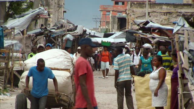 Sequence showing daily life in a Port-au-Prince market area affected by the 2010 Haitian earthquake (footage shot approximately four years after the earthquake).