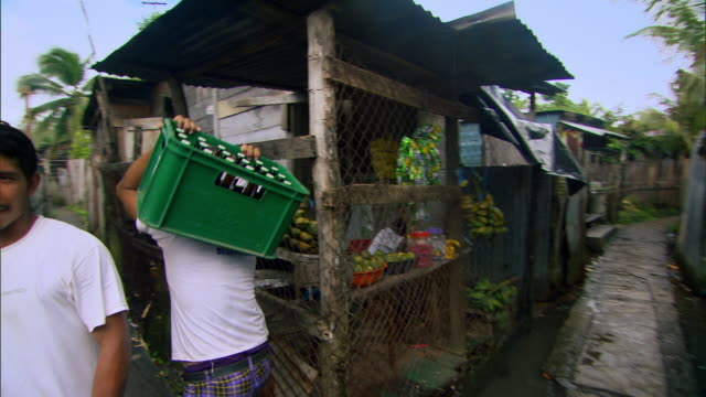 sequence showing daily life on the unusual narrow pedestrian streets of a residential area of bluefields, south caribbean autonomous region (racs), nicaragua. - nicaragua stock videos and b-roll footage