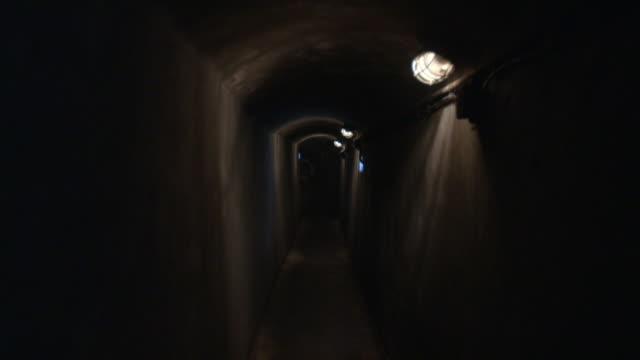 sequence showing dark tunnels in a sewer in austria. - fluorescent light stock videos & royalty-free footage