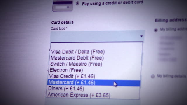 sequence showing debit card charges being applied whilst shopping online - kauf per kreditkarte stock-videos und b-roll-filmmaterial