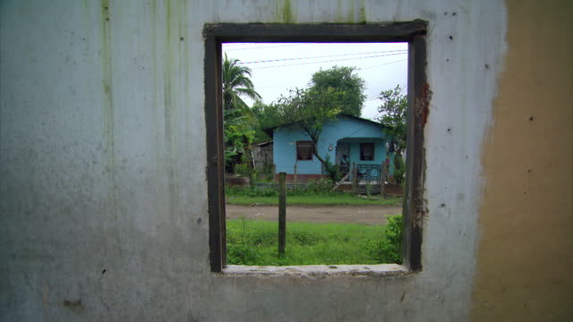 Sequence showing defaced and abandoned buildings, possibly used as 'crazy houses', in Chamelecón, an area affected by high levels of violent crime in San Pedro Sula, Honduras, including views of graffiti allegedly by the MS13 gang.