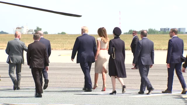 sequence showing donald and melania trump walking to and boarding marine one after arriving in the uk at stansted airport london - setting stock videos & royalty-free footage