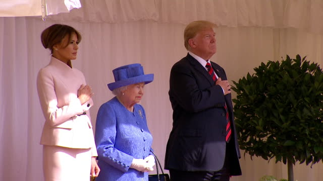 sequence showing donald and melania trump with queen elizabeth ii listening to the us national anthem played by the queen's guard at windsor castle - british royalty stock videos & royalty-free footage