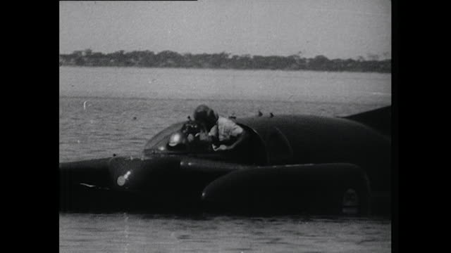 vídeos y material grabado en eventos de stock de sequence showing donald campbell's wife and friends celebrating after her successfully sets a new water speed record in australia - hidroplano