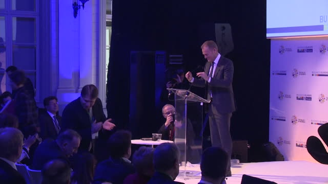 sequence showing donald tusk taking to the podium before his keynote speech at businesseurope day 2018 - keynote speech stock videos and b-roll footage