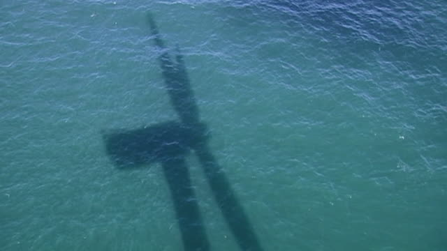 sequence showing elevated views of an offshore windfarm on the british coastline. - shadow stock videos & royalty-free footage