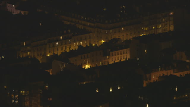 sequence showing elevated views of typical mid-rise buildings forming streets in central paris, france. - stereotypically upper class stock videos and b-roll footage