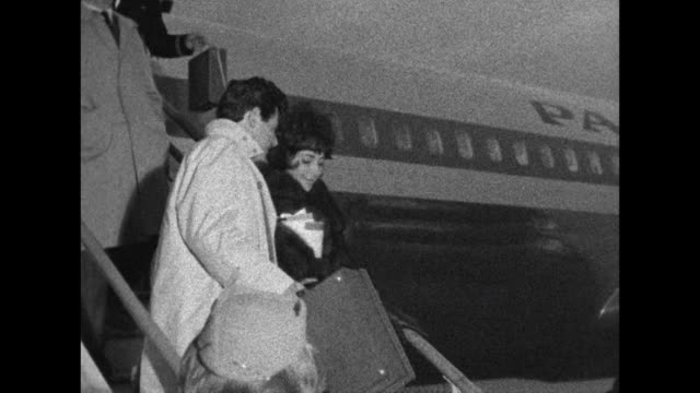 Sequence showing Elizabeth Taylor and Eddie Fisher disembarking a passenger aircraft at London Airport
