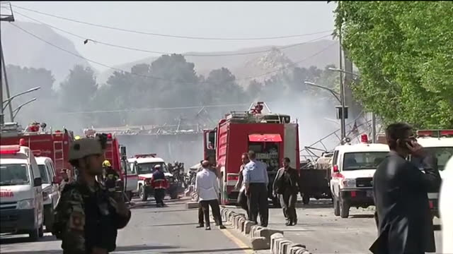 sequence showing emergency vehicles in the centre of kabul after an explosion outside the german embassy and people waiting to be allowed into an... - kabul stock-videos und b-roll-filmmaterial