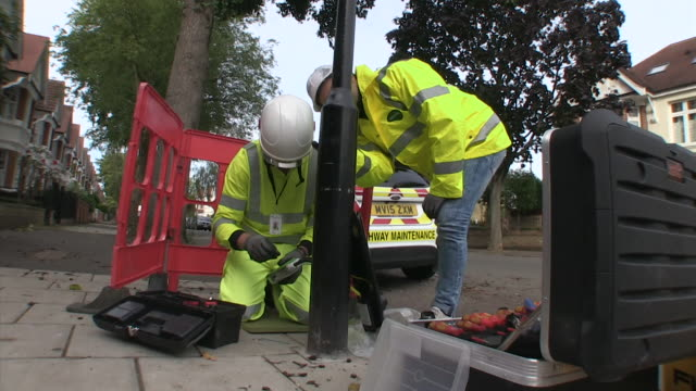 Sequence showing engineers installing a residential electric vehicle charging point London October 2017 NNPV131R ABSA627D