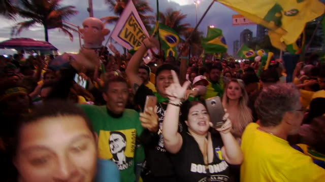 vídeos y material grabado en eventos de stock de sequence showing enthusiastic supporters of jair bolsonaro celebrating his victory after the vote has taken place and before the results have been... - 2018