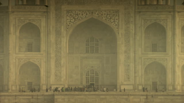 sequence showing evening sunlight bathing the taj mahal on a muggy day, india. - taj mahal stock videos and b-roll footage