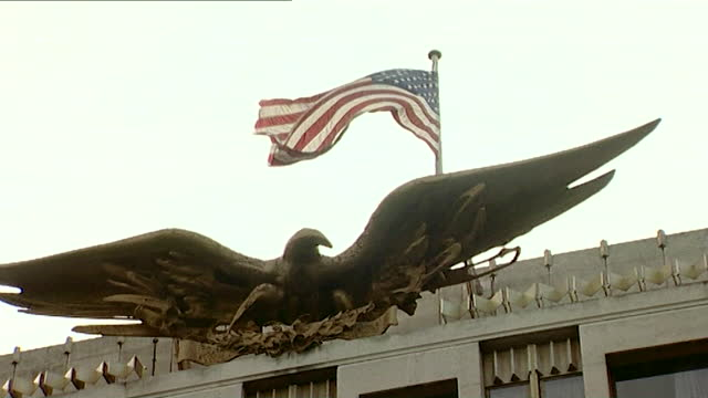 sequence showing exteriors of the us embassy in mayfair, london on september 11th 2001. soldier standing on roof. large golden eagle emblem on the... - bird of prey stock videos & royalty-free footage