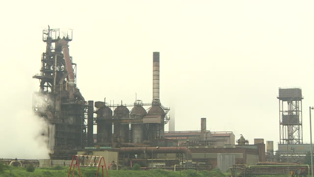 sequence showing external views of port talbot steelworks in wales - schornstein konstruktion stock-videos und b-roll-filmmaterial