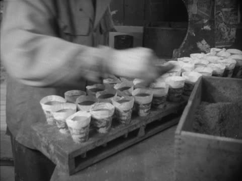 sequence showing factory workers putting together fireworks at a fireworks factory. - gunpowder explosive material stock videos & royalty-free footage