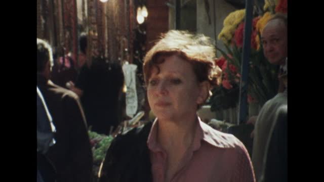 Sequence showing fashion designer Thea Porter walking through Berwick Street market