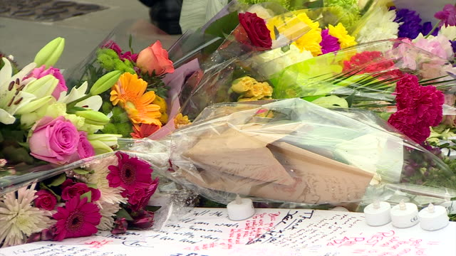 sequence showing floral tributes for the murdered mp jo cox in westminster - murder stock videos & royalty-free footage