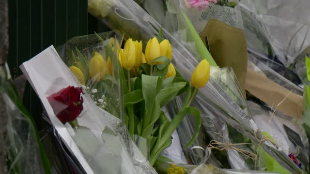 sequence showing flowers and wreaths being laid outside the former police station of lt col arnuad beltrame who died in the terrorist attack in... - carcassonne stock videos & royalty-free footage
