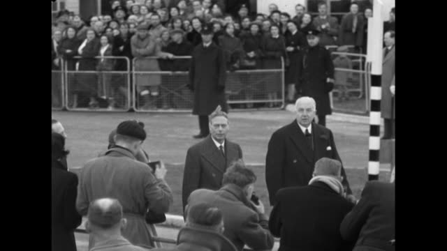 Sequence showing George VI the Queen and Princess Margaret walking to a terminal building at London Airport