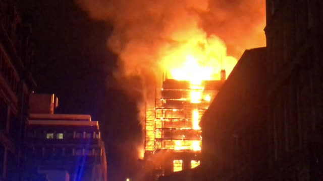 Sequence showing Glasgow School of Art ablaze at night