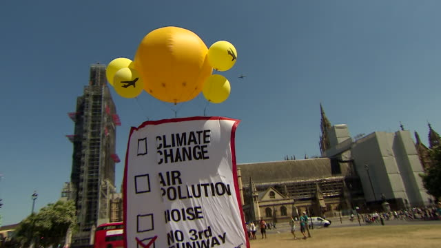 sequence showing greenpeace protestors in westminster protesting against a third runway at heathrow - greenpeace stock videos & royalty-free footage