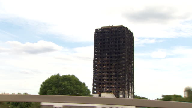 Sequence showing Grenfell Tower one month after the fire from the Westway elevated duel carriageway west London