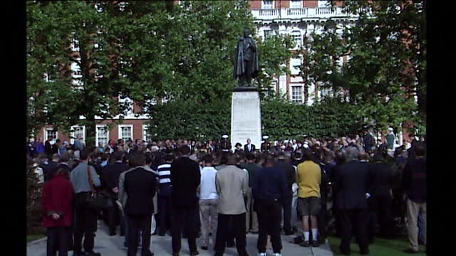 sequence showing groups of people in cities around the uk holding a three minute silence at 11am for the victims of the 9/11 attack. chimes of big... - real people stock videos & royalty-free footage