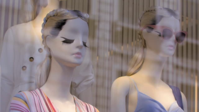 sequence showing high street mannequins in shop windows, uk. - window display stock videos & royalty-free footage