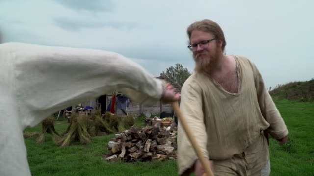 sequence showing historical viking reenactor fighting in sweden - oresund region stock videos & royalty-free footage