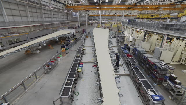 sequence showing internal shots of the airbus factory in broughton north wales - production line stock videos & royalty-free footage