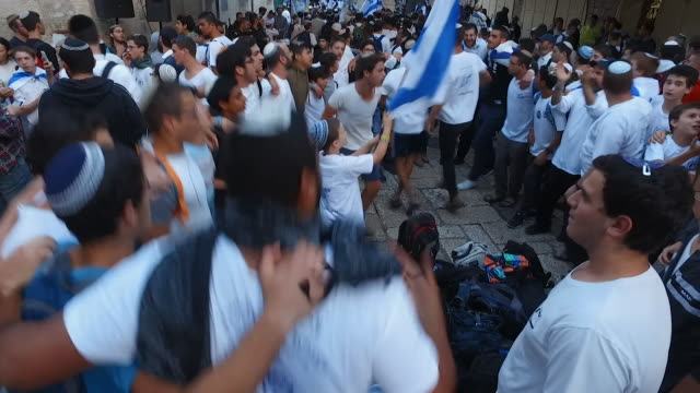 sequence showing israelis celebrating in the streets of jerusalem - showing stock videos & royalty-free footage
