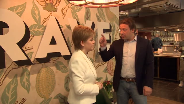 sequence showing jamie oliver chatting with nicola sturgeon - jamie oliver stock videos & royalty-free footage