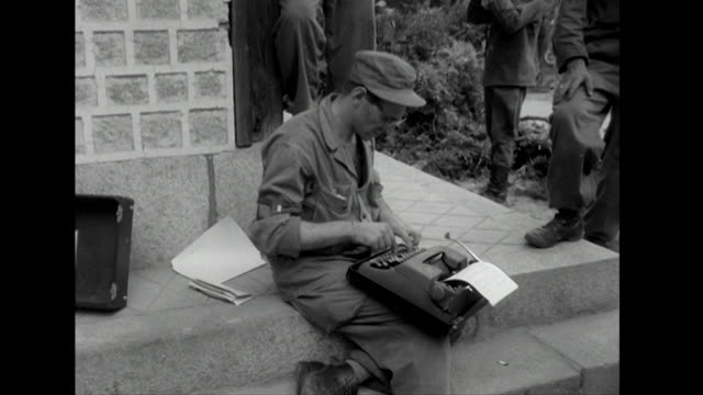 Sequence showing journalists reporting on the Korean War peace talks being held at Kaeson North Korea