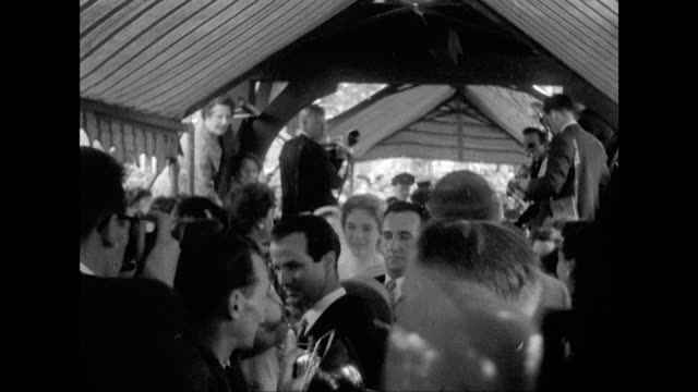 sequence showing julie andrews arriving at st mary's church in weybridge for her wedding to tony walton. - celebrities video stock e b–roll