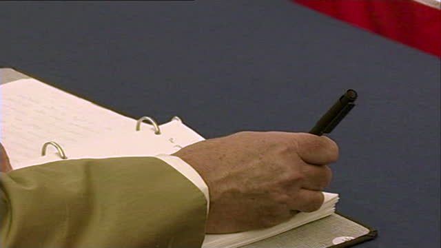 sequence showing ken livingstone, mayor of london in 2001, signing a book of condolence for the victims of the 9/11 attacks; september 13th, 2001. - 2001 stock videos & royalty-free footage