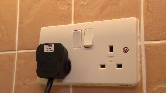 sequence showing kitchen electrical appliances being switched on. - electrical plug stock videos & royalty-free footage