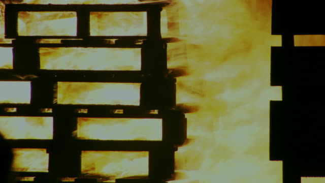 sequence showing large, fiercely-raging bonfire constructed by a loyalist/unionist community as part of the 'eleventh' celebrations, embers, a secure police vehicle and reflections on a car, belfast, northern ireland. - protestantism stock videos & royalty-free footage