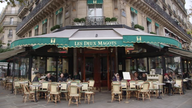 sequence showing les deux magots cafe in saintgermaindesprés paris france rushes taken from bbccom/culture absa734n - stereotypical stock videos & royalty-free footage