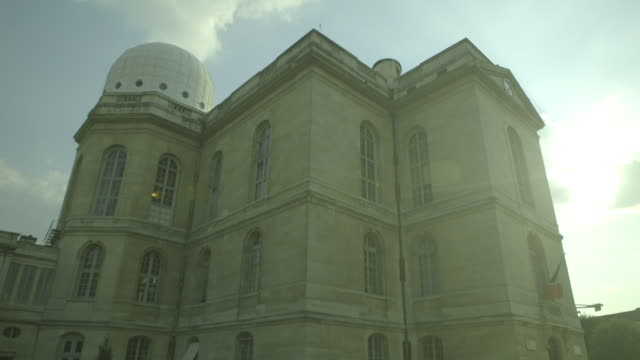 sequence showing light and dark views of the imposing exterior of the observatoire de paris, 14th arrondissement, paris, france. - observatorium stock-videos und b-roll-filmmaterial