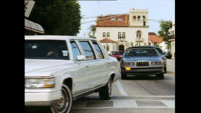 sequence showing luxurious cars in palm beach; 1991 - stereotypically upper class stock videos & royalty-free footage