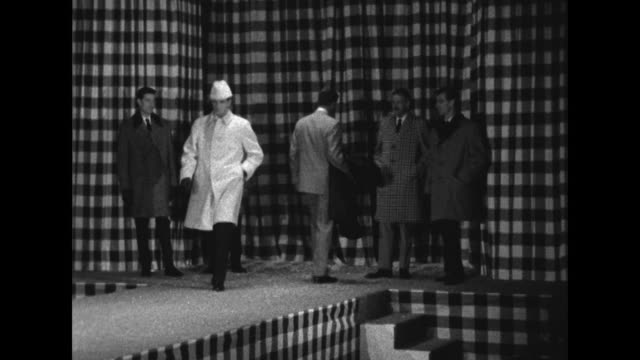 sequence showing male models walking the catwalk, wearing winter coats and suits designed by hardy amies. - sfilata video stock e b–roll