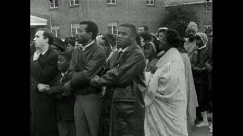 sequence showing marchers holding hands swaying and singing while police block the road in selma, alabama; 13th march, 1965.rear view of police... - 1965 stock videos & royalty-free footage