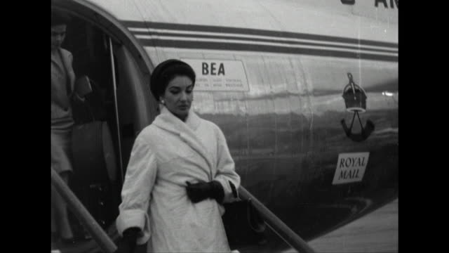 stockvideo's en b-roll-footage met sequence showing maria callas arriving at london airport - 1950 1959
